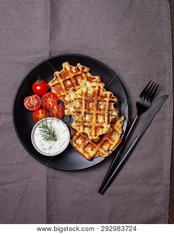 Healthy Breakfast. Savory Potato Dill Waffles With Tomatoes, Tzatziki On A Black Plate