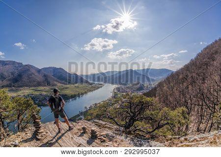 View Of Wachau Valley With Man Watching Spitz Village In Austria