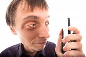 Ugly weirdo man looking at cellphone isolated on white background. poster