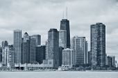 Chicago city urban skyline black and white with skyscrapers over Lake Michigan with cloudy blue sky. poster