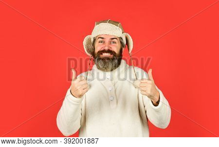 Bearded Funny Hipster. Perfect Accessory. Bearded Man Wear Hat With Ear Flaps Red Background. Soft F