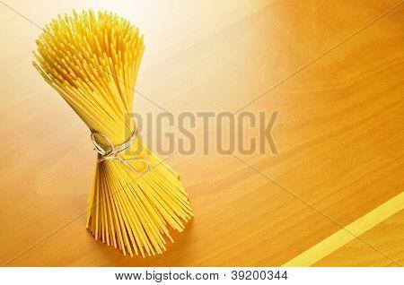 Spaghetti Pasta On A Wooden Chopping Board