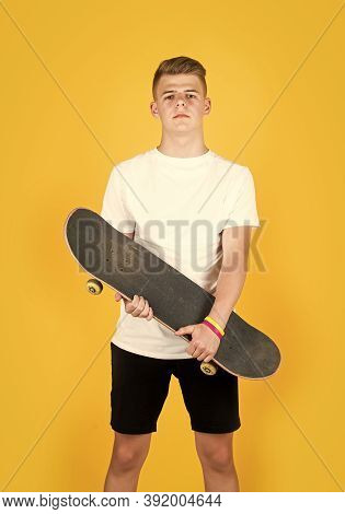 Hipster Teen Boy Hold Penny Board. Urban Boy With Penny Skateboard. Young Kid Has Riding Hobby. City