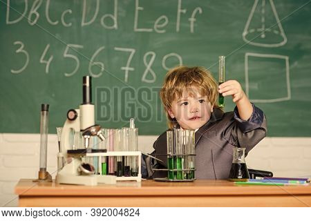 Little Boy At Lesson. Back To School. Science Experiments With Microscope In Lab. Little Boy Is Maki
