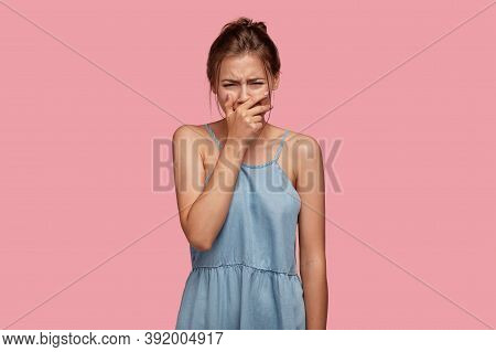 Sad Dejected Disappointed Young Woman Cries In Despair As Lost Something Valuable, Expresses Negativ