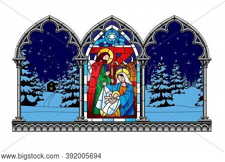 Stained glass window depicting a Christmas scene in an engraved gothic frame on a winter background