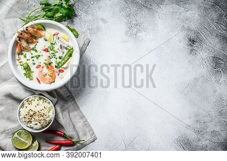 Homemade Tom Kha Gai. Coconut Milk Soup In A Bowl. Thai Food. Gray Background. Top View. Copy Space
