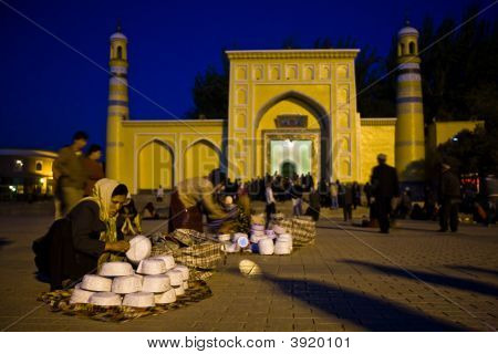 Woman Selling Skull Caps In Front Of Mosque