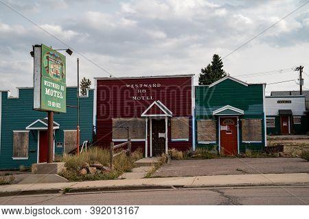 Cripple Creek, Colorado - September 16, 2020: The Abandoned Westward Ho Motel Against A Cloudy Sky