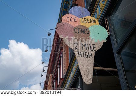 Cripple Creek, Colorado - September 16, 2020: Sign For Two Mile High Ice Cream Store Against A Blue