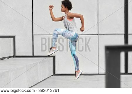 Healthy Fit Woman Runs Up On Stairs, Wears Comfortable Clothes And Trainers, Has Jogging Workout, Do