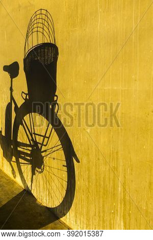 Shadow From Bicycle On Concrete Wall Vertical