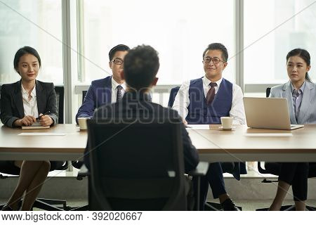 Young Asian Business Man Being Interviewed By A Group Of Corporate Human Resources Executives