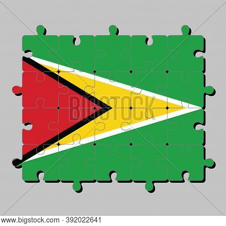 Jigsaw Puzzle Of Guyana Flag In A Green Field With The Black Red Triangle And White Golden Triangle.