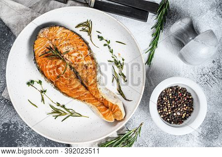 Roasted Salmon Steak. Healthy Seafood. Gray Background. Top View