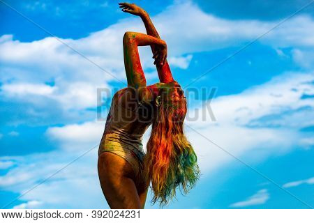 Colorful Holi Splash On Body. Beautiful Young Woman With Amazing Body-art Color. Color Womans Body W