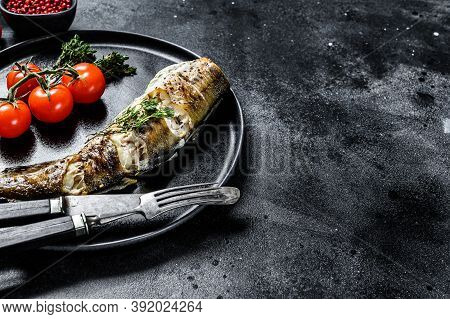 Baked Pollock Cooked In A Savory Marinade. Black Background. Top View. Copy Space