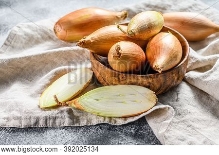 Yellow Shallot Onions, Cut In Two Halves. Gray Background. Top View