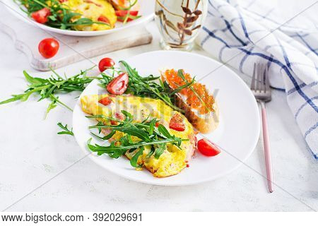 Omelette With Tomatoes, Cheese, Ham And Sandwich Wich Red Cavier On Plate.  Frittata - Italian Omele