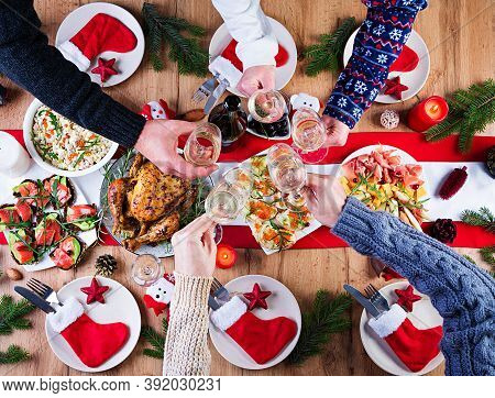Baked Turkey. Christmas Dinner. The Christmas Table Is Served With A Turkey, Decorated With Bright T