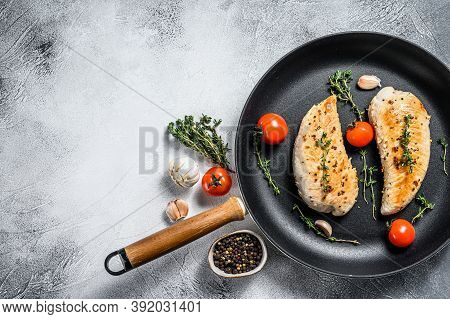 Grilled Turkey Steaks In A Pan. Breast Fillet. White Background. Top View. Copy Space