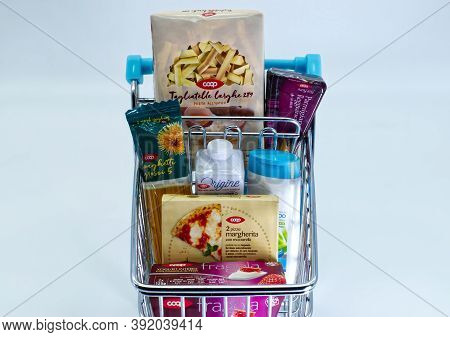 Bologna / Italy - October 28, 2020: Shopping Cart With Various Original Coop Products. Coop Is The B