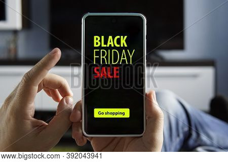 People, Sale Consumerism, Advertisement Concept - Close Up Of Man Hand Holding Smartphone With Black