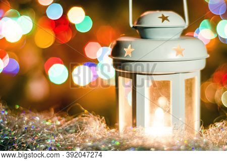 Christmas Card With Glowing Lantern And Blurred Garland Lights