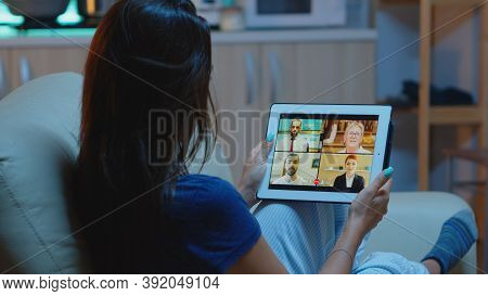 Freelancer Using Tablet For Video Conference, Working Late At Night From Home. Remote Worker Having