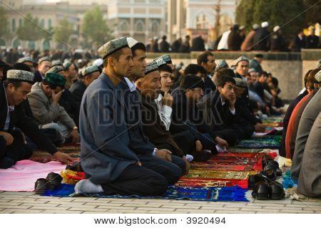 Muslim Worshipers Kneel On Prayer Carpets