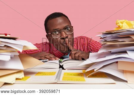 People, Secrecy And Education Concept. Close Up Portrait Of Dark Skinned Clever Student Keeps Index