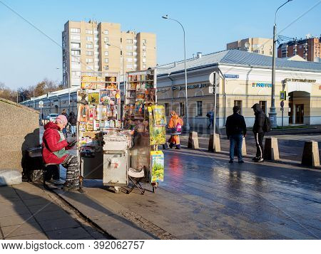 Moscow. Russia. October 28, 2020. A Woman Sells Newspapers And Magazines On The Sidewalk Of A City S