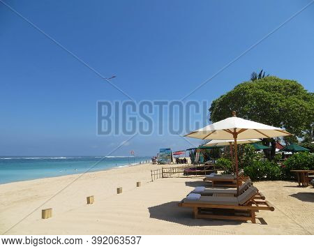Badung Bali, Indonesia - October 3, 2019: Row Of Beach Chairs On The Seaside Of Bengiat Beach Nusa D