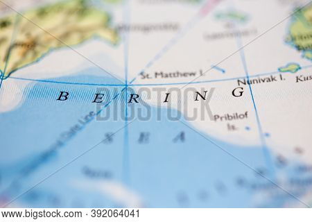 Shallow Depth Of Field Focus On Geographical Map Location Of Bering Sea Off Coast Of Russia And Alas