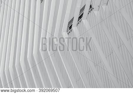 White Facade Building Abstract Background. Modern Futuristic Facade Building. Steel Cladding Corruga