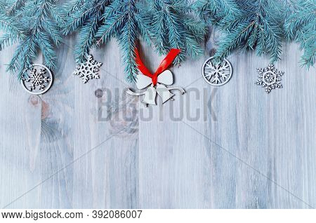 Christmas background. Christmas toys, blue fir tree on the wooden background. New Year and Christmas still life, free space for Christmas  text