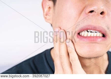 Man Suffering From Toothache, Hand Touching Wisdom Tooth. Dental, Healthcare Concept