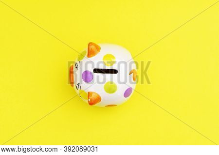 Piggybank On A Yellow Background. To Save , Saving Money For Affordable Things, Financial Concept .p