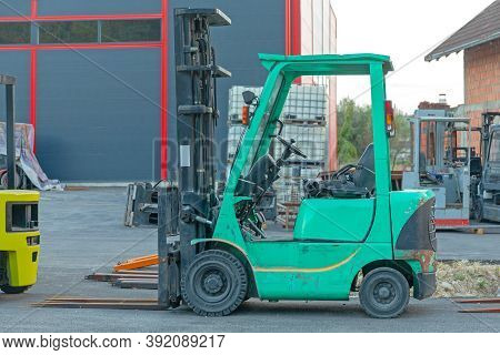 Forklift Truck In Front Of Warehouse Building