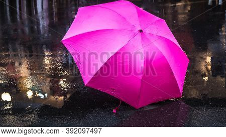 Pink Canvas Umbrella After The Rain. Pink Umbrella On The Wet Abstract Season Weather.
