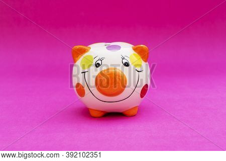 Piggybank On A Red Background. To Save , Saving Money For Affordable Things, Financial Concept .pigg