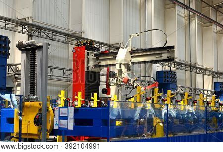 Robotic Welding Complex In The Production Workshop Of An Industrial Plant. Complex Production Line,