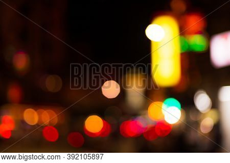 Urban Bokeh Light Blurred Lights Abstract Background In The City.