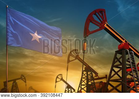 Somalia Oil Industry Concept, Industrial Illustration. Fluttering Somalia Flag And Oil Wells On The