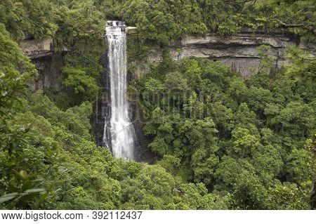 Waterfall Into A Rainforest In Santa Catarina, Brazil.