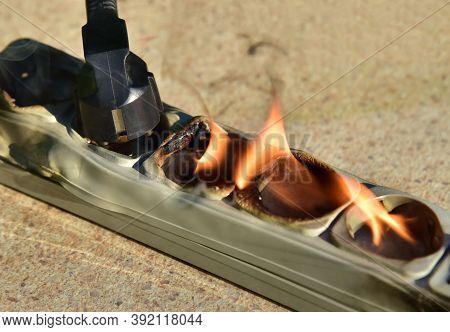 Outlets With Switche Caught Fire In Room. Overloaded Electrical Current Or Short In Device From Many