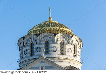 Vladimir Cathedral In Chersonesos Close-up Of The Dome Of The Building Against The Blue Sky. The Fal