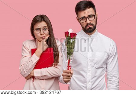 People, Dating And Relationship Concept. Displeased Bearded Man In White Elegant Shirt Gives Girlfri
