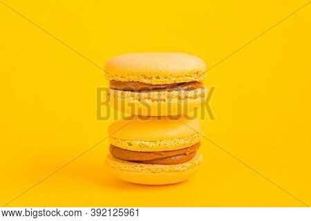 Sweet Almond Colorful Yellow Macaron Or Macaroon Dessert Cake Isolated On Trendy Yellow Modern Fashi