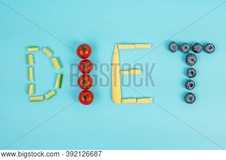 Diet Arrangement Of Fruit And Vegetable; Blueberries, Cherry Tomatoes, Cucumber And Baby Corn On Blu